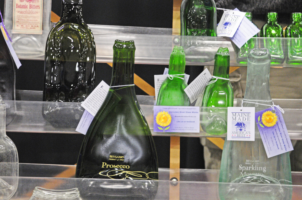 A shelf of slumped glass work by Luiza Brown, of Kennebec River Glassworks, is on display during a craft show Saturday at the Augusta Civic Center.