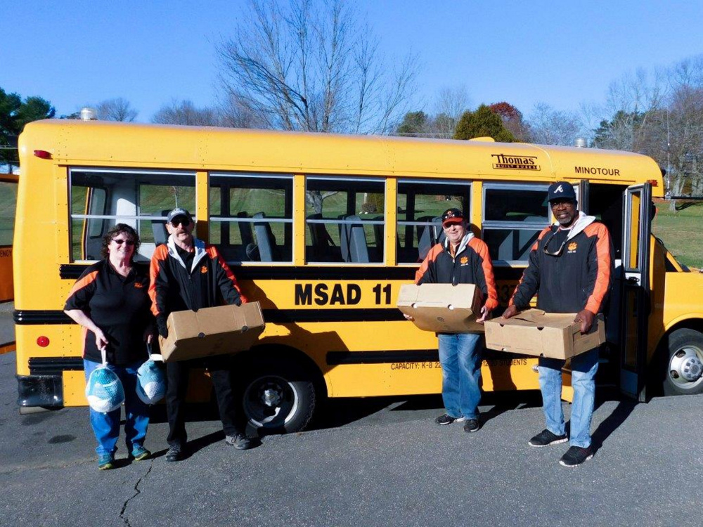 School Administrative District 11's two dozen bus drivers helped raise $250 toward buying turkeys for Gardiner Area High School students' annual Thanksgiving turkey drive. Because Cony Street Hannaford in Augusta donated 30 turkeys, the drivers will be able to dedicate the funds they raised for turkeys to buyping presents for Gardiner area children. From left are MSAD 11 bus drivers Dorothy Kirk, Richard Reutershan, Dean Paquette and Charles Wilson.