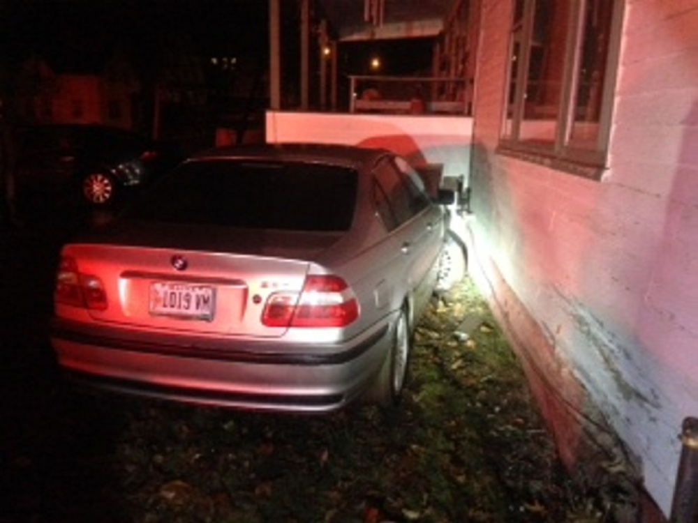 Police allege that Joshua R. Perkins drove his 2001 BMW 3-Series into a house on Kelsey Street early Saturday morning.