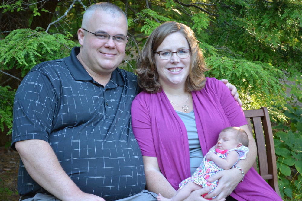 Mathew Guilfoyle, 38, a Winthrop dispatcher who died on Thanksgiving Day, is shown in this photo with his wife, Nicole, and daughter Eleanor.