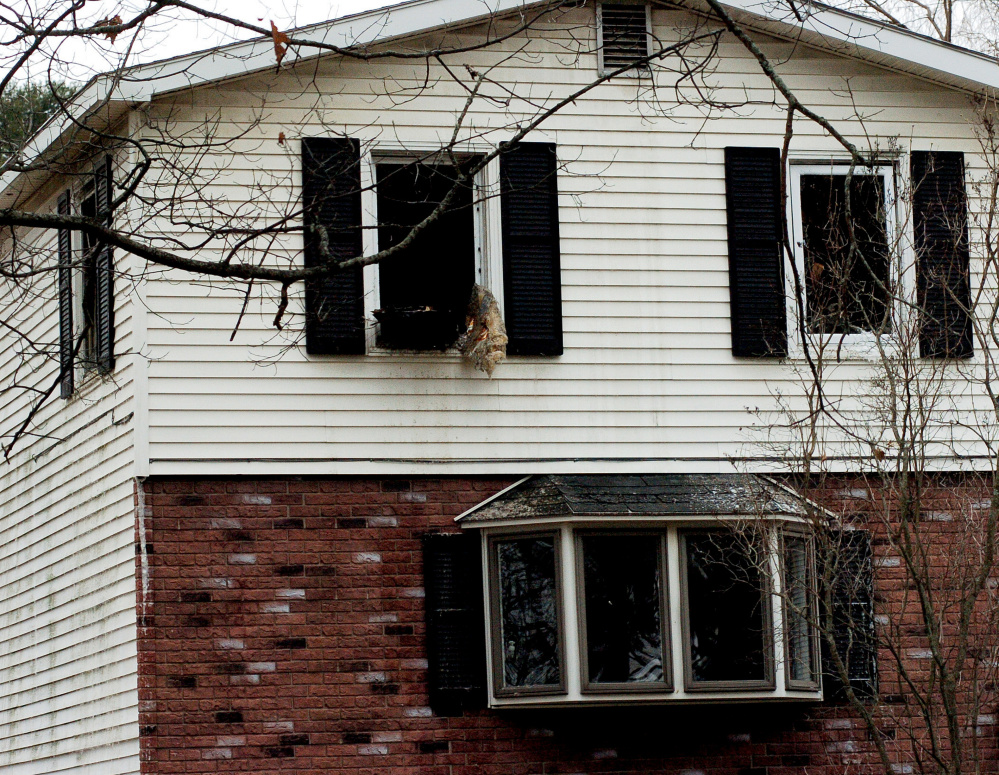 Blackened windows are left shattered and open Tuesday after fire the previous night damaged a home at 82 Mechanic St. in Norridgewock, displacing a family of five.