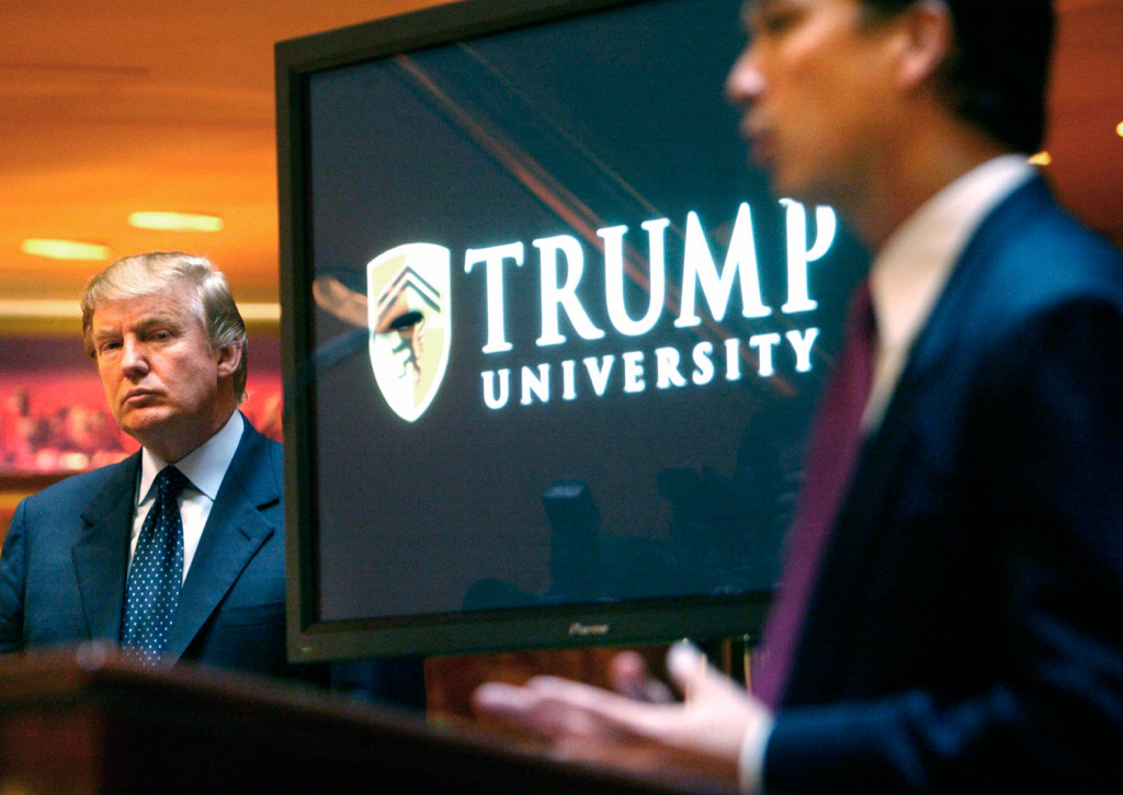 Real estate mogul and Reality TV star Donald Trump, left, listens as Michael Sexton introduces him at a 2005 news conference in New York where he announced the establishment of Trump University. A settlement was reached Friday in the civil fraud trial involving the now-defunct university.