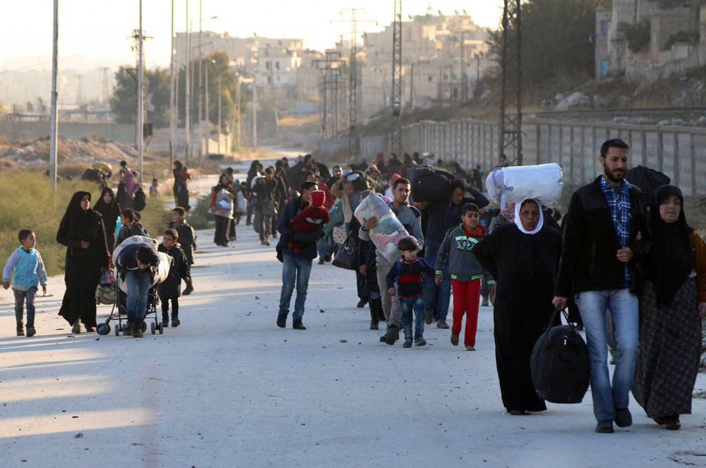 This Nov. 27 photo provided by the Rumaf, a Syrian Kurdish activist group, which has been authenticated based on its contents and other Associated Press reporting, shows people fleeing rebel-held eastern neighborhoods of Aleppo into the Sheikh Maqsoud area that is controlled by Kurdish fighters, in Syria.
