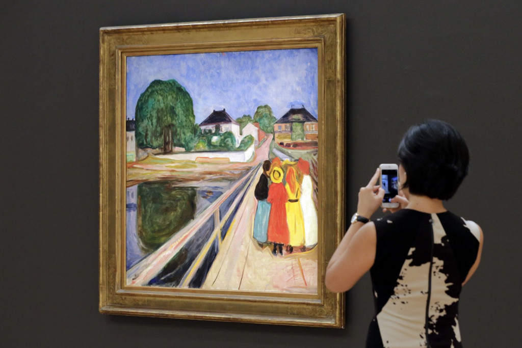 "A work by Norwegian artist Edvard Munch, ""Girls on the Bridge,"" is displayed at Sotheby's, in New York. The painting sold at auction for more than $54 million."
