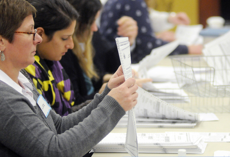The hand recount of the marijuana referendum results began Dec. 5 at the Department of Public Safety in Augusta. The recount was suspended late Thursday, after about 30 percent of the ballots cast had been reviewed with no significant change in the totals.