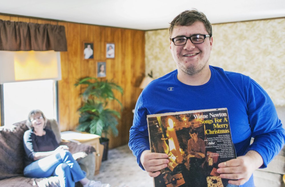 Ryan Dufour, 18, who has autism spectrum disorder, lost services after graduating from high school and is now on a long waiting list. He was raised by his grandmother Leslie Sullivan, left.
