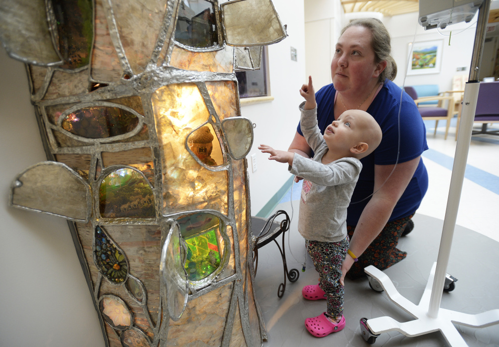 Patient Madison Arndt, 2, and her mother, Ashley, of Brunswick, explore the stained-glass tree dedicated Wednesday at the Barbara Bush Children's Hospital, part of Maine Medical Center in Portland.