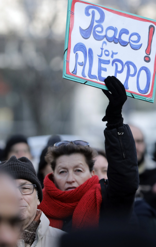 People demonstrate in front of the Russian embassy in Berlin on Wednesday to protest the bombing of Aleppo, Syria.