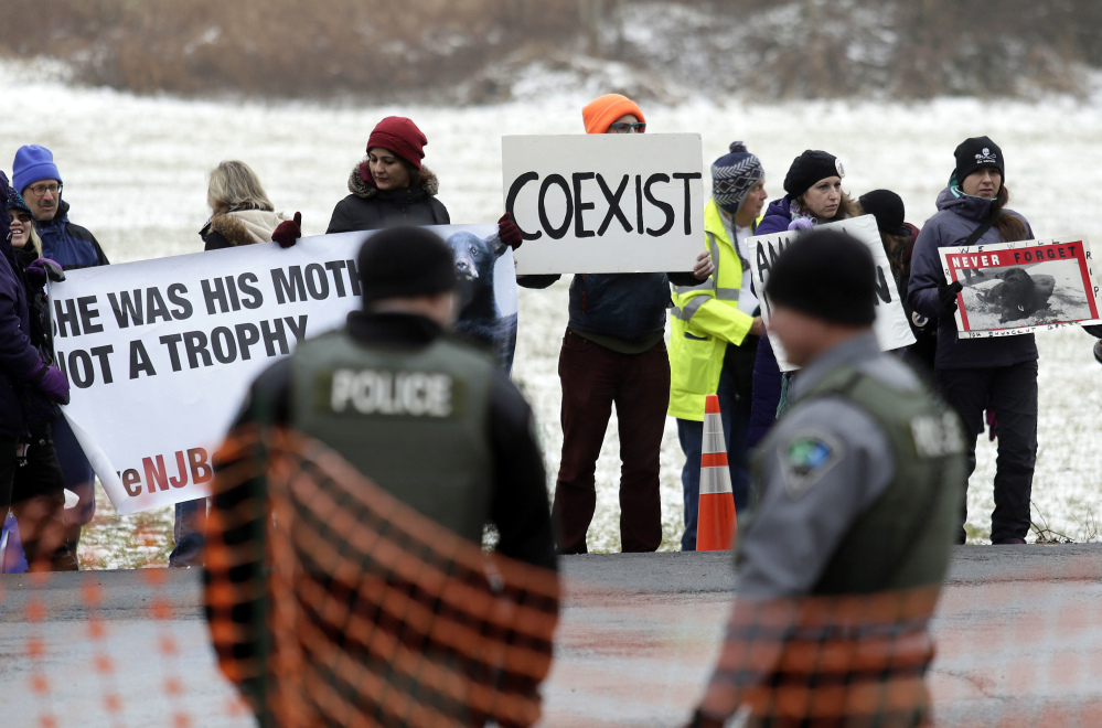 Protesters gather last Monday on the first day of the New Jersey black bear hunt at the Whittingham Wildlife Management Area in Fredon.