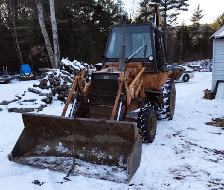 John Bubar allegedly used this front-end loader to pick up the mobile home and drop it on the ground three times.