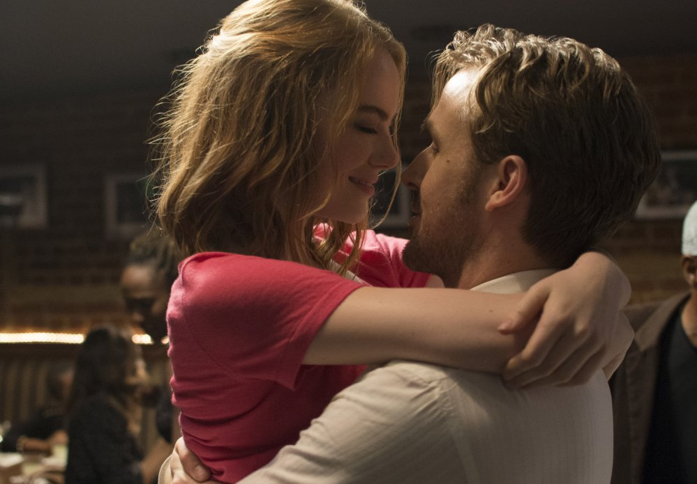 """Ryan Gosling, right, and Emma Stone in a scene from, """"La La Land."""" The film was nominated for a Golden Globe award for best motion picture musical or comedy."""
