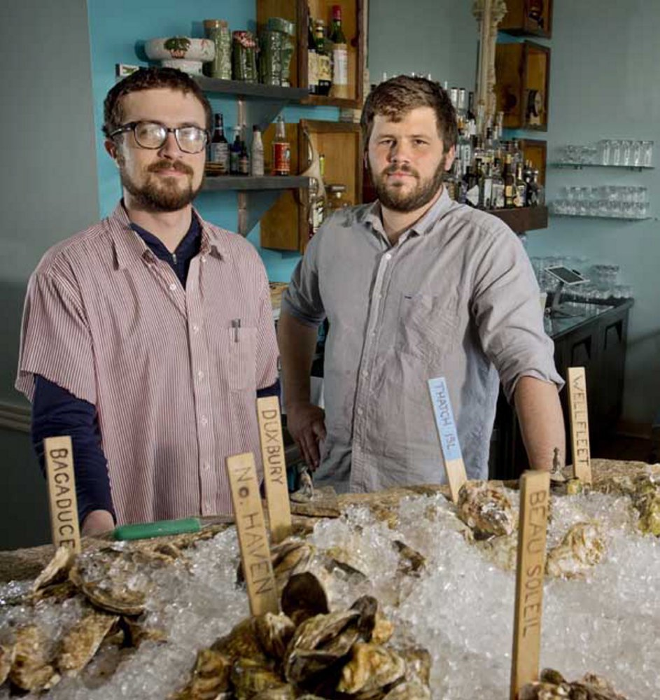 """Mike Wiley, left, shown in 2013 with Andrew Taylor, fellow owner and chef of Eventide Oyster Co., says of a planned expansion into Boston: """"It's less seasonal down there."""""""