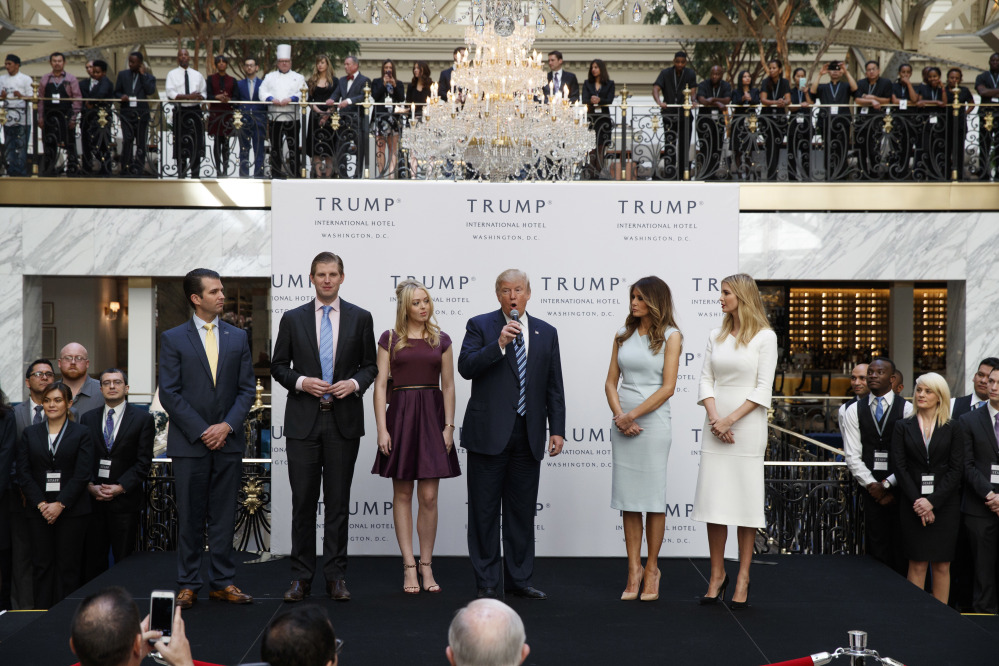 Associated Press/Evan Vucci President-elect Donald Trump is shown with from left, Donald Trump Jr., Eric Trump, Melania Trump, Tiffany Trump and Ivanka Trump at an event when he was still a candidate. He has postponed an announcement until January on how he will avoid a conflict of interest with his worldwide business empire once he takes office.