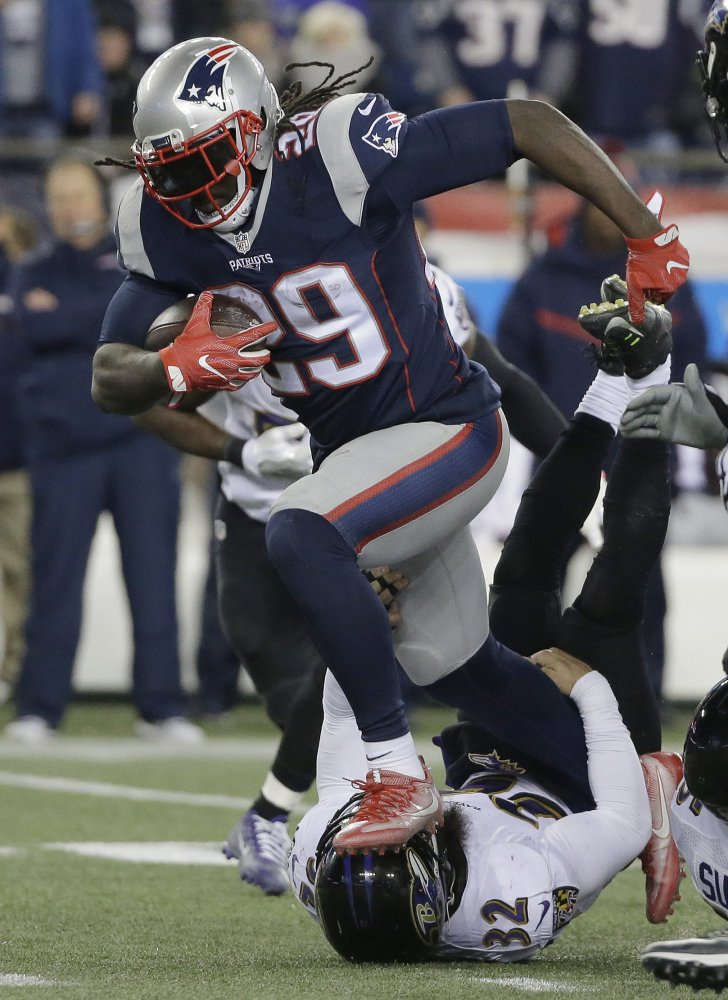 Patriots running back LeGarrette Blount runs over Ravens safety Eric Weddle in the second half of Monday, night's game in Foxborough. Blount rushed for 72 yards on 18 carries, passing 1,000 yards for the season.