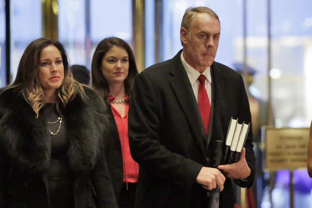 Rep. Ryan Zinke, right, R-Mont., shown arriving at Trump Tower in New York on Monday, is the president-elect's choice for secretary of the interior, according to a source with first-hand knowledge of the situation.