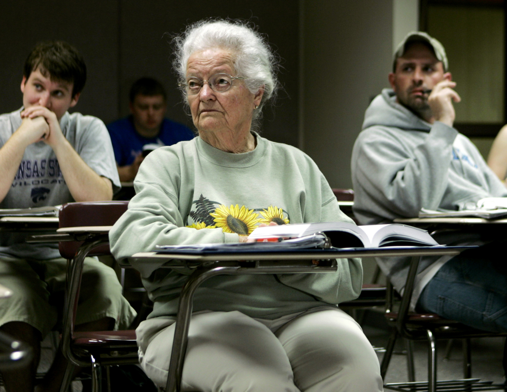 Nola Ochs listens to a lecture at Fort Hays State University in Hays, Kan., in 2007. Ochs moved from her farm to finish her degree there and took classes until she was 100.