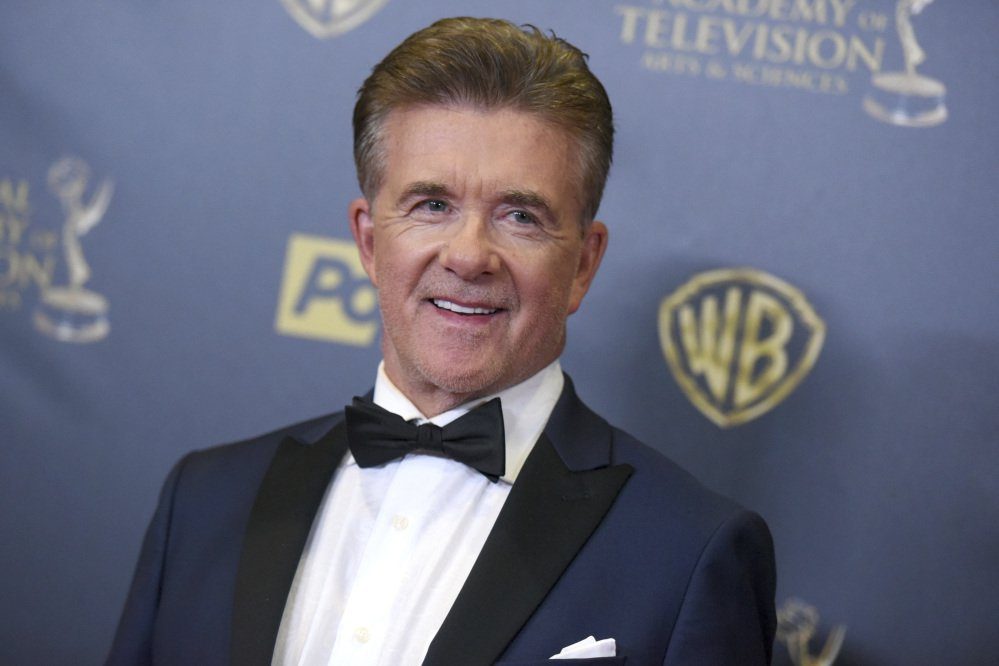 Alan Thicke poses at the 2015 Daytime Emmy Awards in Burbank, Calif. Thicke died Tuesday at the age of 69.