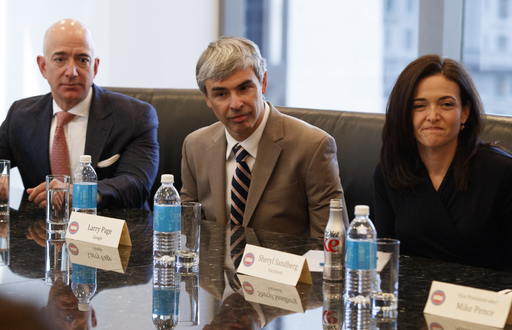 From left, Amazon founder Jeff Bezos, Alphabet CEO Larry Page and Facebook COO Sheryl Sandberg listen as President-elect Donald Trump speaks during a meeting.