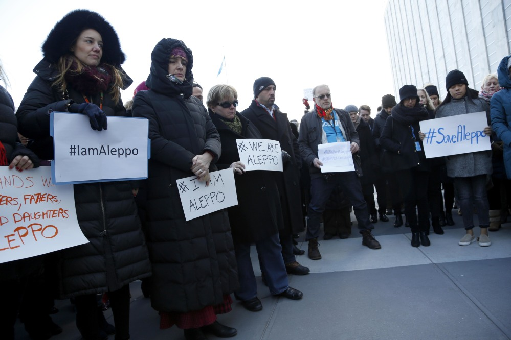 United Nations staff and other supporters assemble on U.N. headquarters grounds to show their solidarity with the people of Aleppo, Syria, on Thursday.