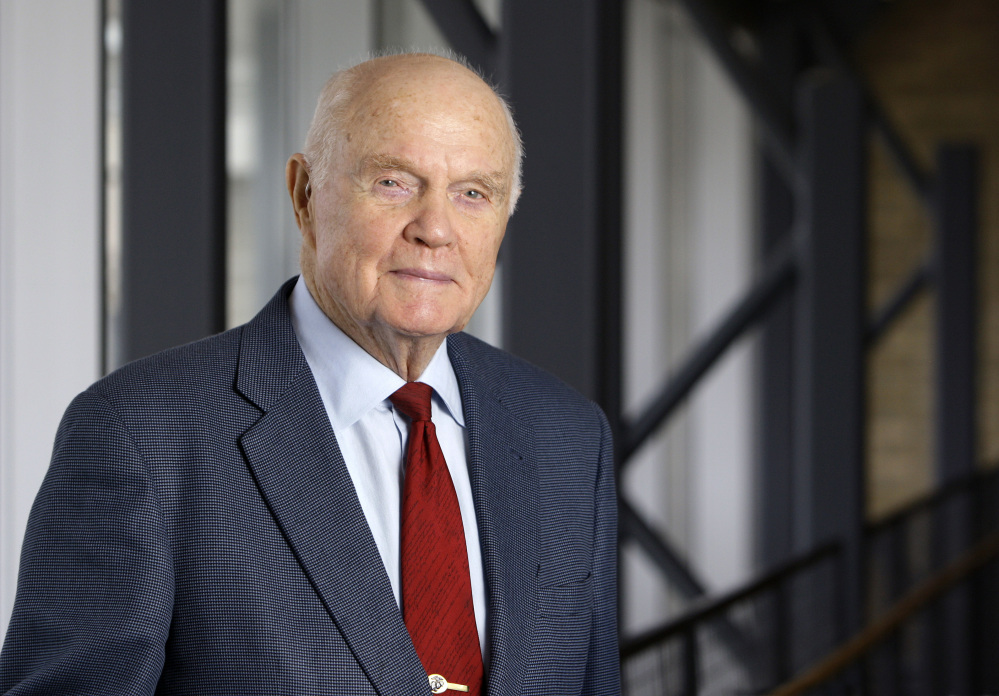 FILE - In this Jan. 25, 2012, file photo, John Glenn poses for a photo during an interview at his office in Columbus, Ohio. Glenn's home state and the nation will begin saying goodbye to the famed astronaut as he lies in state at Ohio's capitol building. A public viewing for the first American to orbit Earth is scheduled to stretch at least eight hours starting at noon on Friday, Dec. 16, 2016, in Columbus. The 95-year-old Glenn died last week. (AP Photo/Jay LaPrete, File)