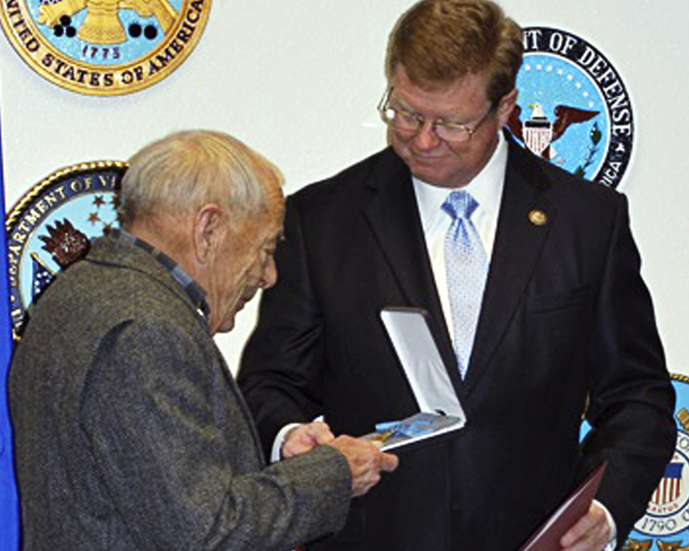 Nevada Rep. Mark Amodei, right, presents the Medal of Honor to Jerry Reynolds in Reno, Nev., on Monday.