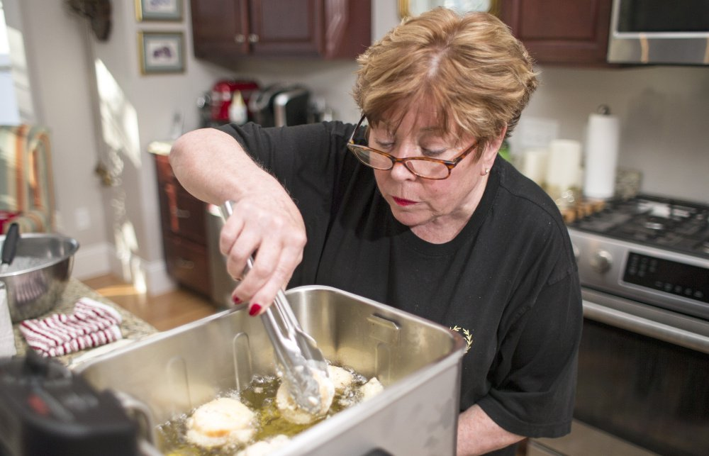Nancy Cerny checks the progress on the battered pieces of baguette for her tried-and-true French toast. It all culminates in a crunchy exterior and soft, creamy inside.