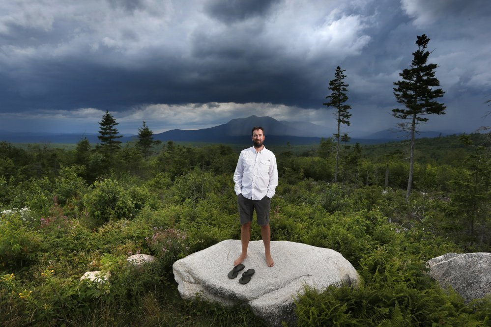 Storm clouds build as Lucas St. Clair visits national monument land in northern Maine. He's not worried about speculation that as president, Donald Trump may dismantle some Obama-designated monuments.