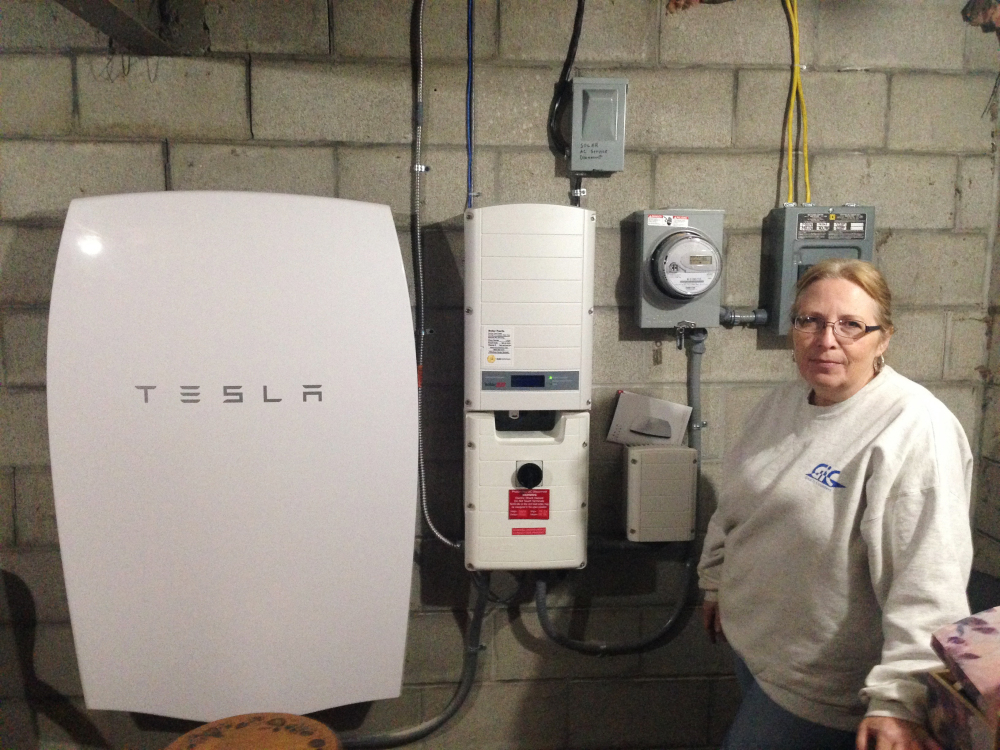 """Associated Press/Dave Gram Rhonda """"Honey"""" Phillips  of Middletown Springs is one of the growing number of Green Mountain Power customers using the Tesla battery to store solar energy when her panels aren't collecting it."""