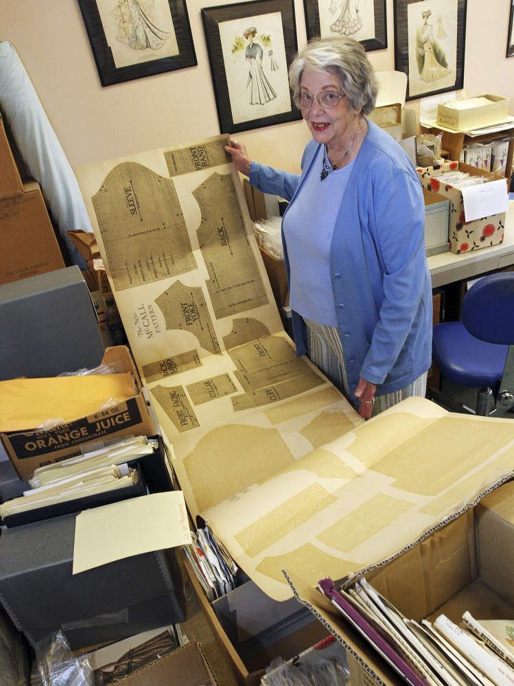 Joy Spanabel Emery, curator of the University of Rhode Island's commercial pattern archive, displays one of 50,000 paper sewing patterns in the collection that she oversees.