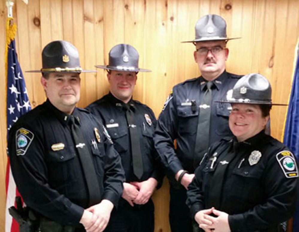 This image from the town of Dixfield's website shows members of the police department.