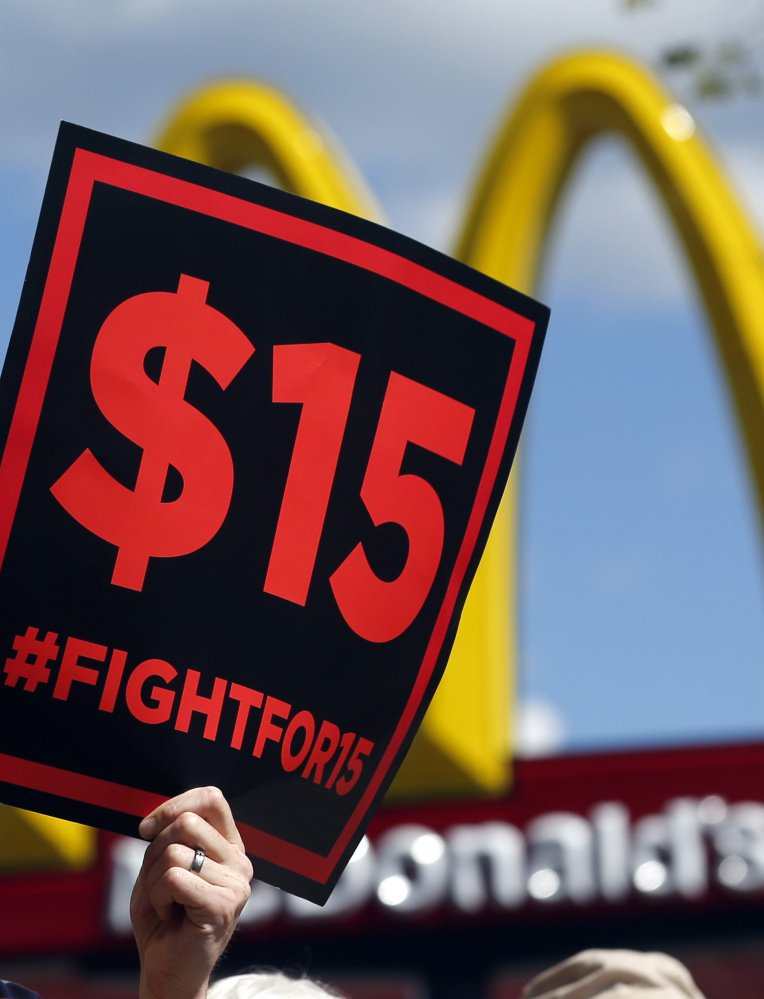Supporters of a $15 minimum wage for fast-food workers rally in front of a McDonald's in Albany, N.Y., in 2015. The base wage is rising to $9.70 in upstate New York on Jan. 1.