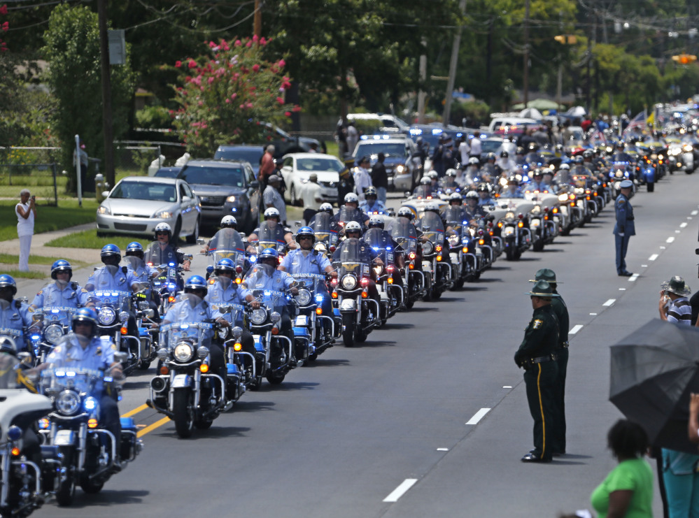 A funeral procession is held for Officer Montrell Jackson in Baton Rouge, La., on July 25.