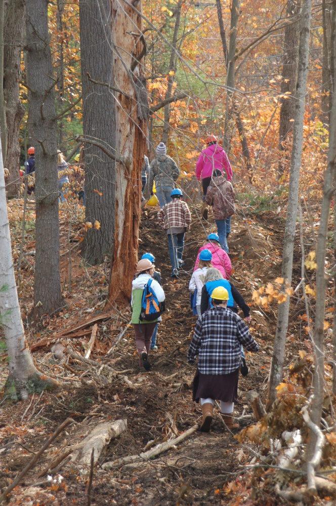 Buckfield students hike into the woods at the Kennebec Land Trust's 360-acre Curtis Homestead Conservation Area.