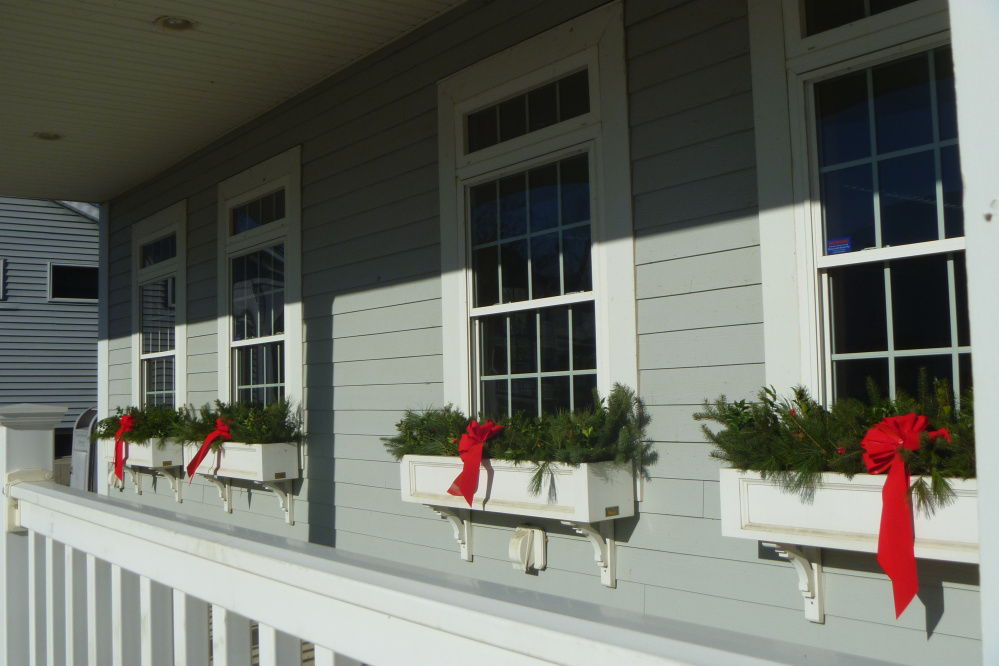 Evergreen boughs and red velvet ribbons adorn the flower boxes at the Newport Cultural Center, which houses the town's library.