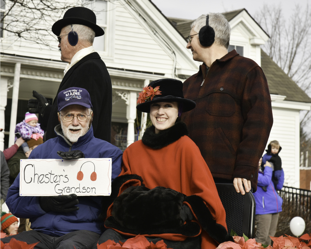 Relatives of Chester Greenwood, a Farmington native who invented earmuffs, led the parade Saturday in celebration of both his invention and the holidays. Shown here, in front from left, are Chester Greenwood's grandson George Greenwood and his great-great-granddaughter Elizabeth Greenwood Thomas. In back, from left, are Clyde Ross and Clinton Greenwood, Chester Greenwood's grandson. Thomas is dressed up as her great-great-grandmother, Isabel Greenwood; and Ross is dressed as Chester Greenwood.