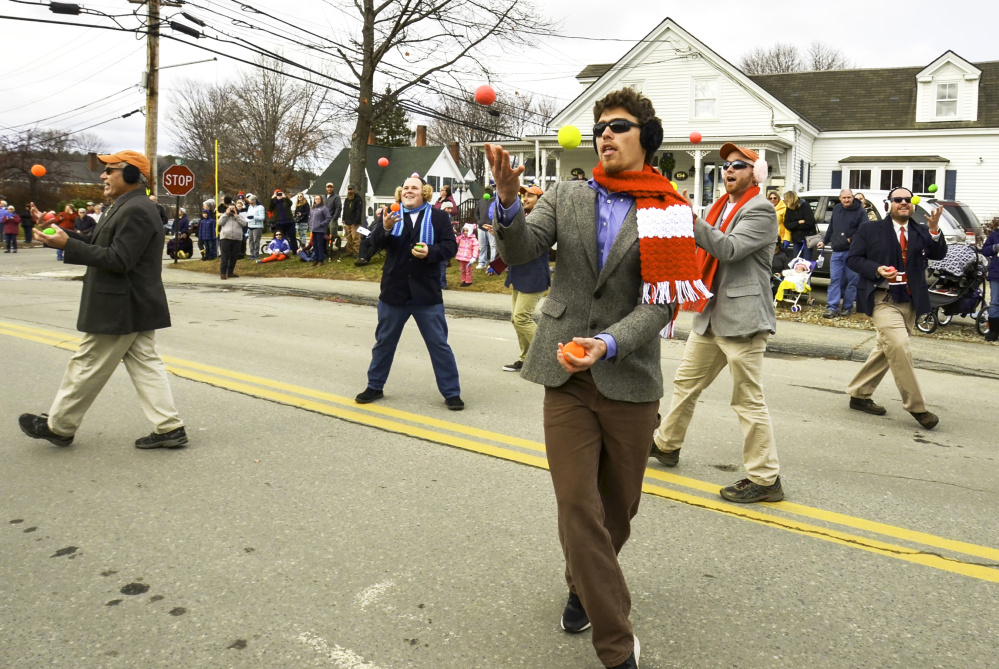 Jugglers don earmuffs Saturday in honor of Chester Greenwood, a Farmington native who invented earmuffs. The parade dedicated to Greenwood takes place annually on the first Saturday of December in downtown Farmington.