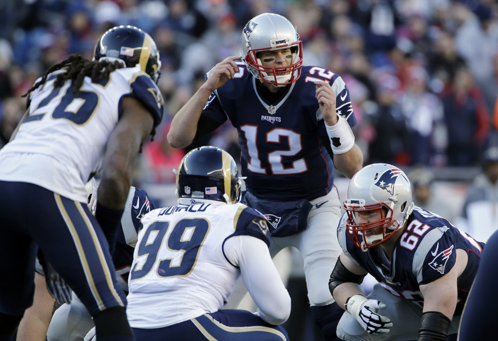 New England Patriots quarterback Tom Brady (12) calls signals at the line of scrimmage against the Los Angeles Rams on Sunday in Foxborough, Massachusetts.