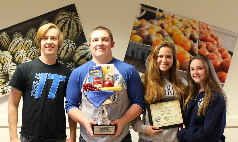 Erskine Academy clas officers who who attended the finale and were presented the cup at the WGME studio in Portland, from left, are Russ Sugg, senior; Jake Peavey, junior;  Elizabeth Sugg, sophomore;  and Parker King, freshman.