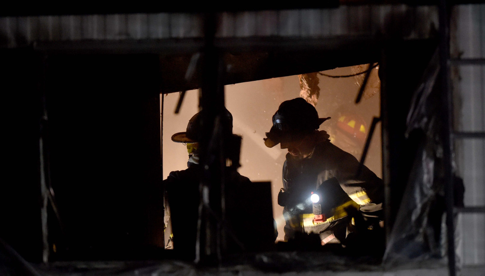 Firefighters from Skowhegan, Canaan and Madison fire departments fought a mobile home fire Friday on North Avenue in Skowhegan.