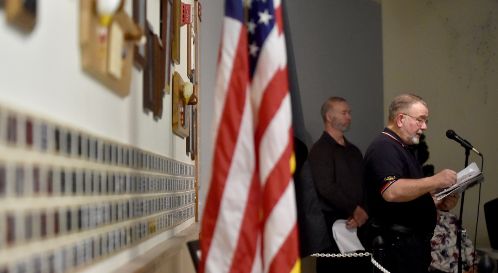 Ken Eaton reads the names of local men killed in the Japanese attack on Pearl Harbor during a remembrance ceremony Wednesday at the Waterville Elks lodge.