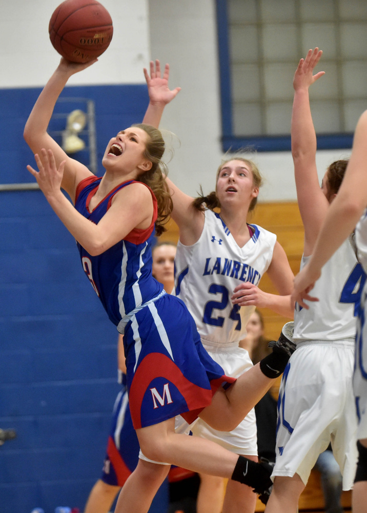 Messalonskee guard Sophie Holmes splits two Lawrence defenders  during a Kennebec Valley Athletic Conference Class A game last season in Fairfield.