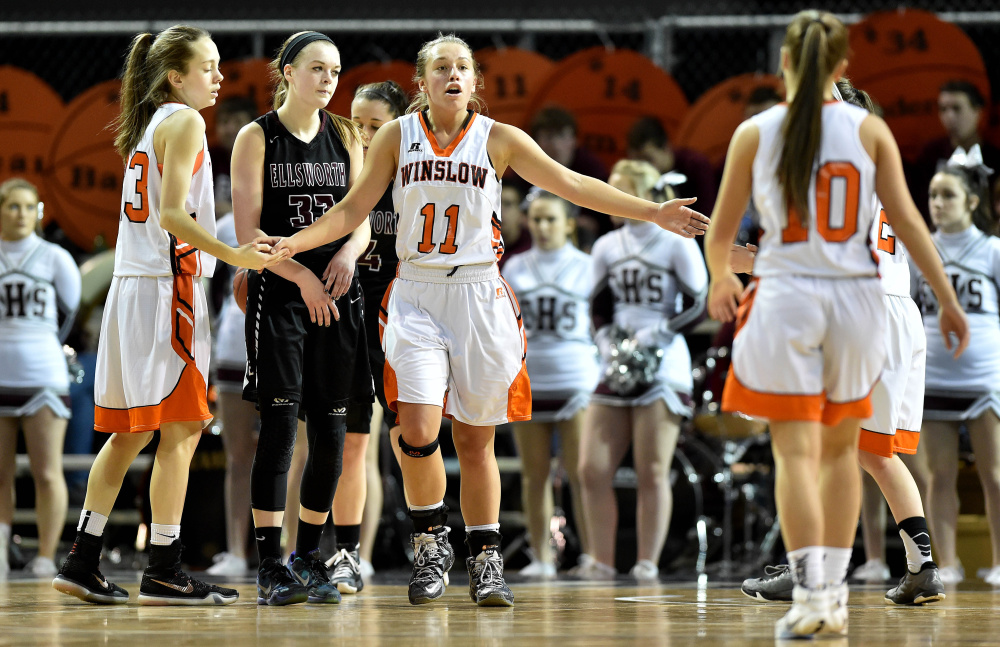 Winslow forward Heather Kervin (11) high-fives teammates after getting fouled in a Class B North quarterfinal against Ellsworth last Feb. 13 in Bangor. Kervin and the Black Raiders hope for another deep postseason run this season.