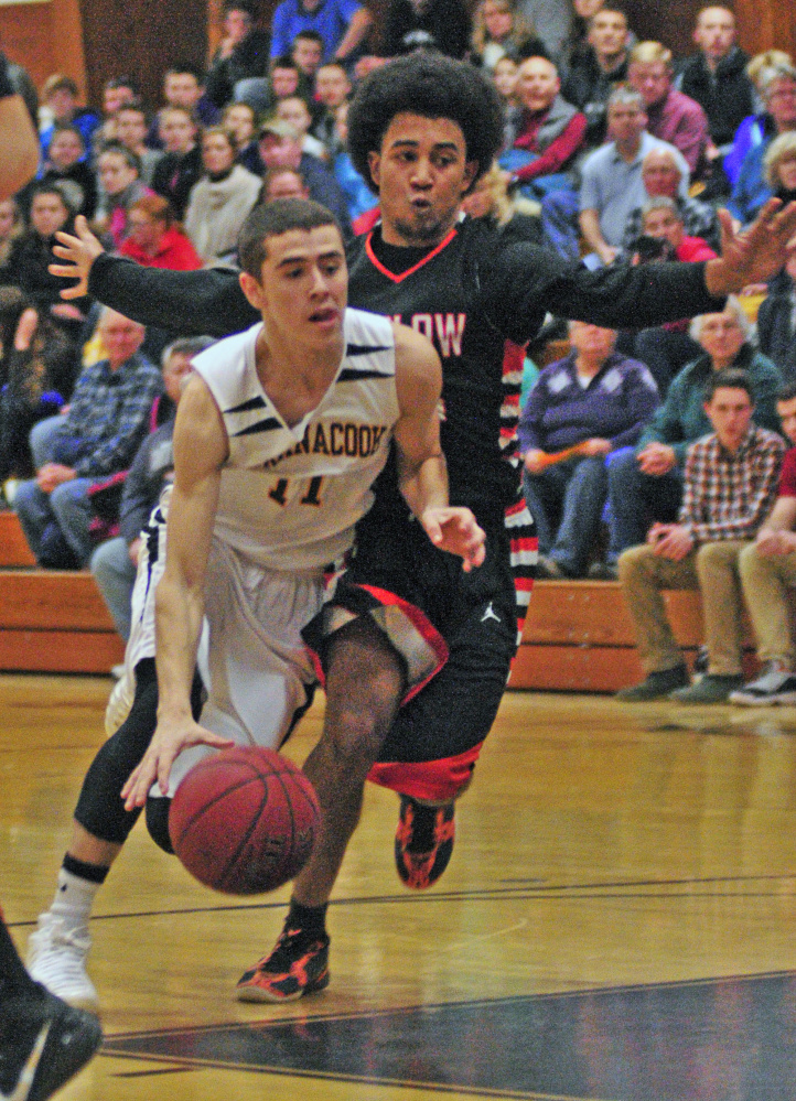 Maranacook guard Kyle Wilbur, left, tries to get around Winslow defender Keanu Earle during a game last Jan. 15 in Readfield. Wilbur and Earle return to the Black Bears and Black Raiders, respectively, this season.