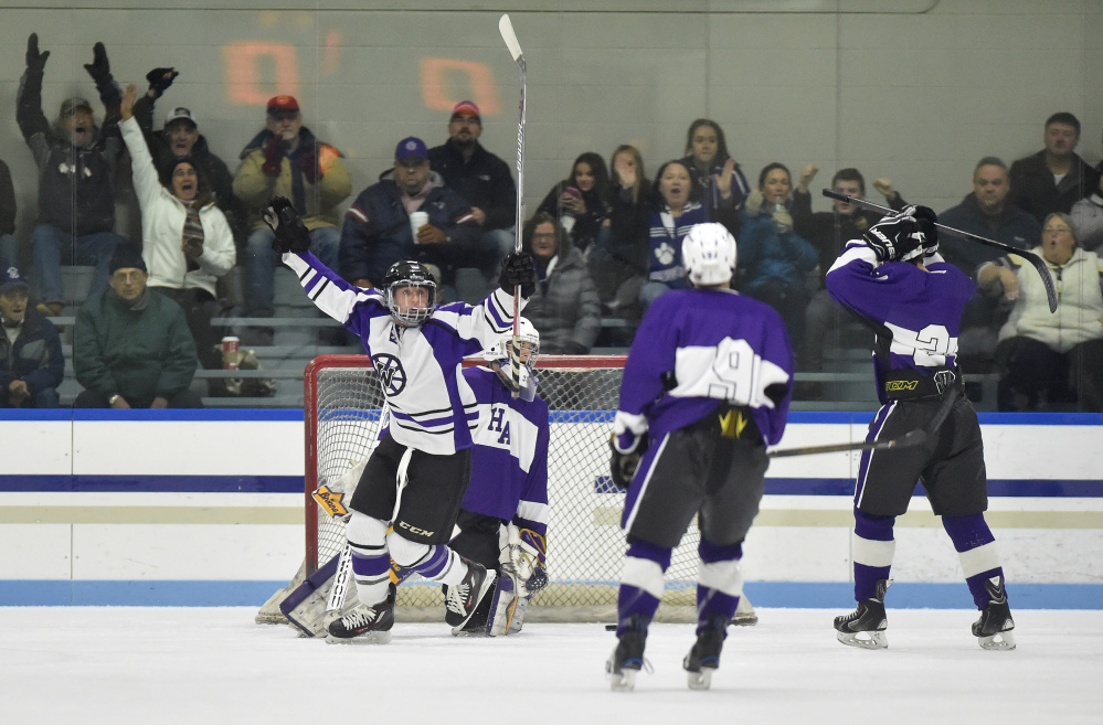 Waterville Senior High School's Justin Wentworth celebrates a goal against Hampden Academy in the first period at Colby College on Saturday night.