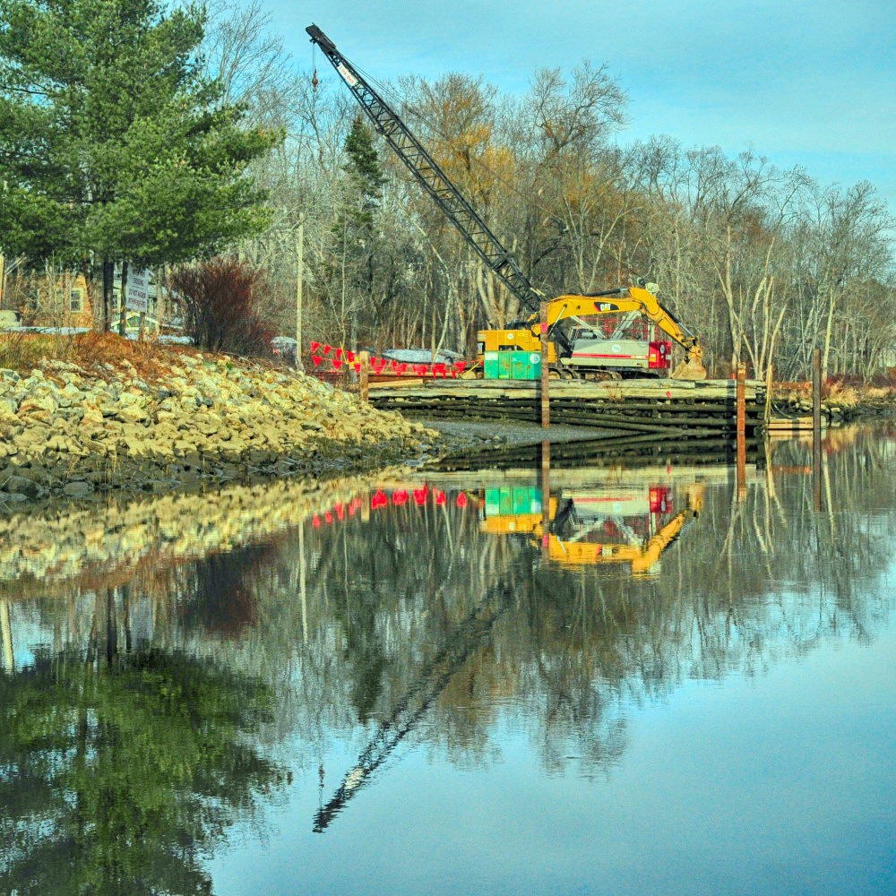 Work has begun on the parking lot for the dock at Steve Powell Wildlife Management Area on Thursday in Richmond. The ferry boat to Swan Island uses the shorefront lot near downtown Richmond.