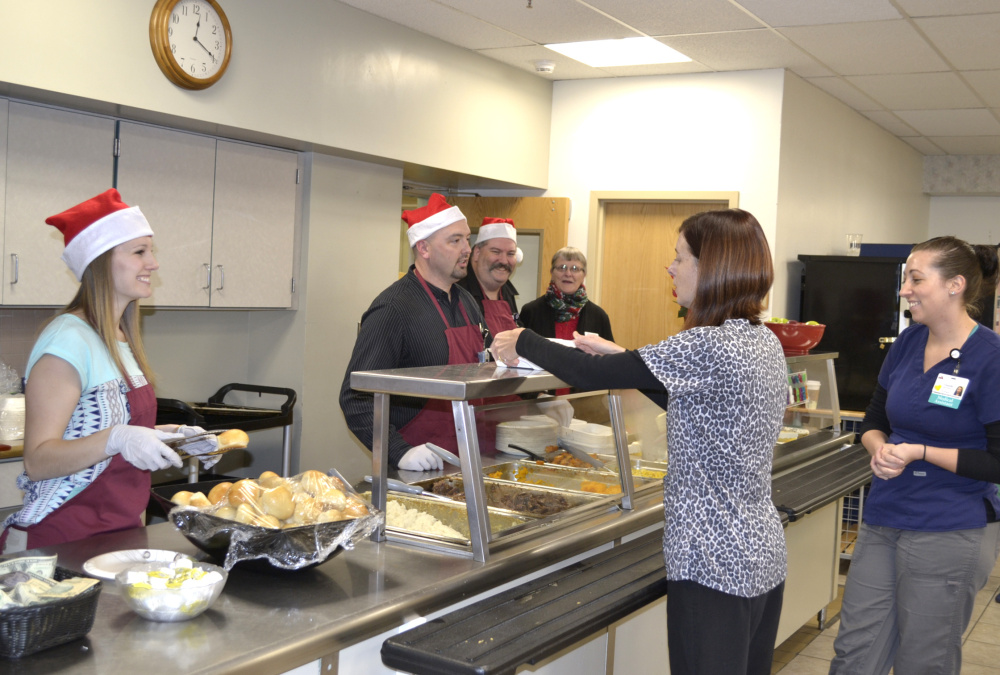 The third annual Meal for a Meal took place on Nov. 30 in the Franklin Memorial Hospital cafeteria in Farmington. Behind the counter, from left, are Katie Drouin, Scott Foster, Greg O'Donal, and Shannon Smith, chamber member.