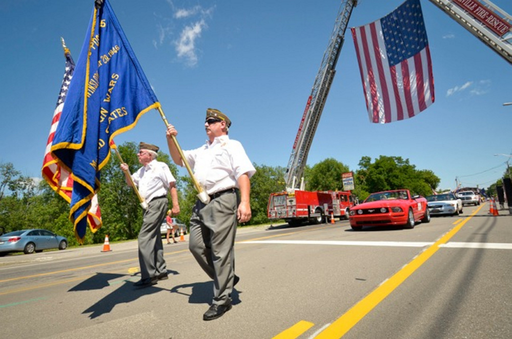 A Veterans of Foreign Wars post marches in the Winslow Family 4th of July Celebration parade on July 4 this year.