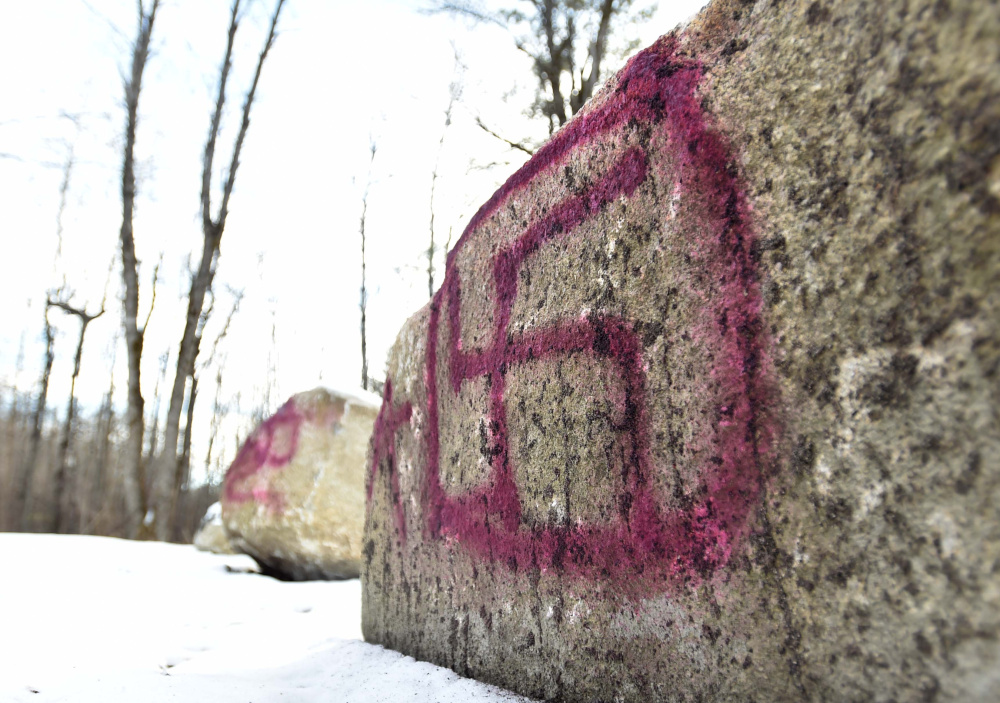 A swastika was painted on a rock at the Devil's Chair parking area at Quarry Road Recreation Area in Waterville, seen on Saturday, but city parks and recreation workers removed the symbol on Monday.