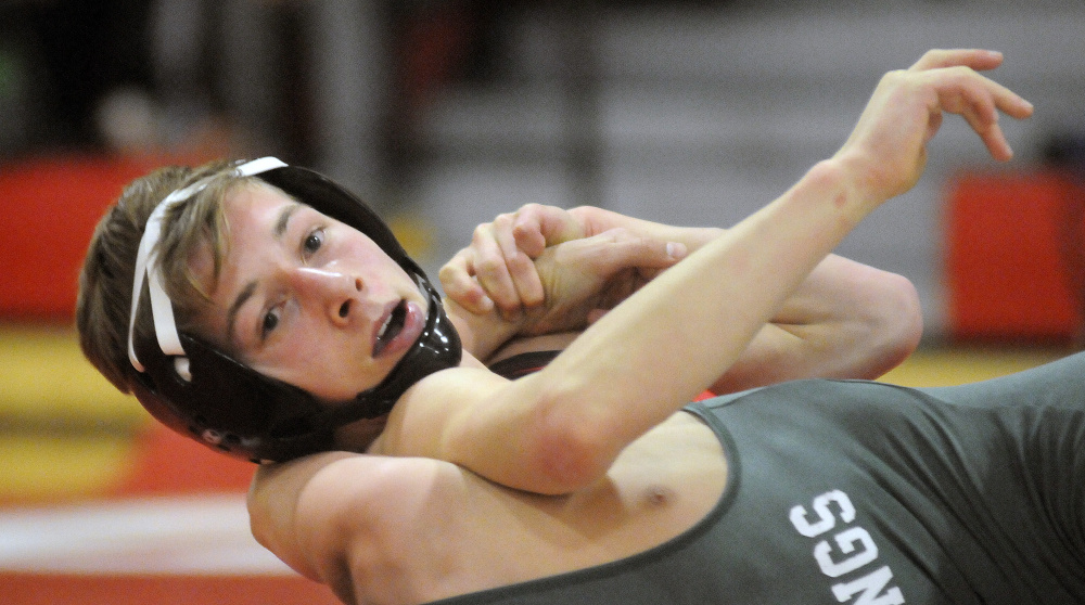 Cony sophomore Noah Dumas grips Oxford Hills wrestler Riley Smith during a match Wednesday night in Augusta.