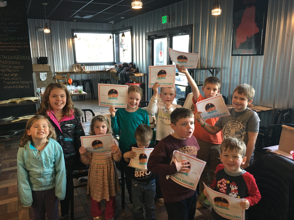Twelve kids from the Augusta area, ages 3 to 14, learned the art of pizza making through hands-on experience called Pizza School. Front, from left, are Charlotte Buccellato, Sabrina Foth, Jonah Baker, Jackson Foth and Hunter Caron. Back, from left, are Emma Buccellato, Madysen Baker, Josiah Baker, Mason Hutchings and Braeden Temple. The Pizza Degree, an Augusta Restaurant that just celebrated its first year of business, hosted the Nov. 4 program.